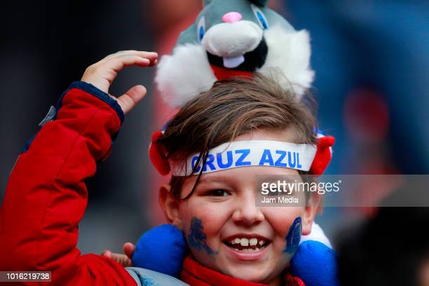 A young fan of Cruz Azul smiles during the match between Cruz Azul v Atlas at Azteca Stadium on August 8 2018 in Mexico City Mexico