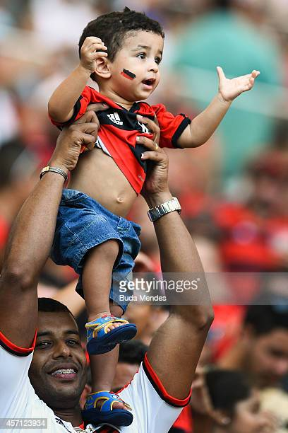 A young fan of Flamengo cheers before a match between Flamengo and Cruzeiro as part of Brasileirao Series A 2014 at Maracana Stadium on October 12...
