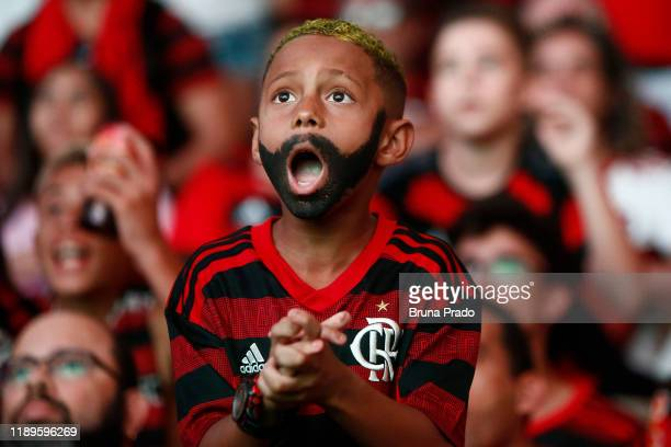 A young fan of Flamengo reacts as they watch the Flamengo v River Plate Copa CONMEBOL Libertadores 2019 Final at Maracana Stadium on November 23 2019...