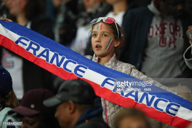 Young fan of France holds up a France scarf during the 2019 FIFA Women's World Cup France group A match between France and Korea Republic at Parc des...