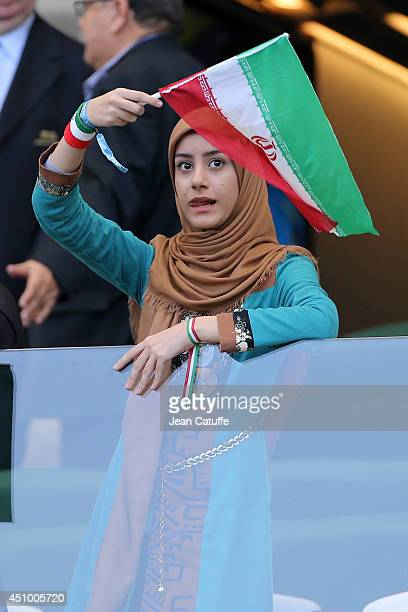 A young fan of Iran cheers for her team during the 2014 FIFA World Cup Brazil Group F match between Argentina and Iran at Estadio Mineirao on June 21...