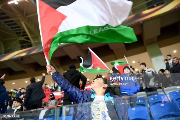 A young fan of Istanbul Basaksehir's waves a Palestinian flag during the UEFA Europa League football match Istanbul Basaksehir FK vs SC Braga at the...