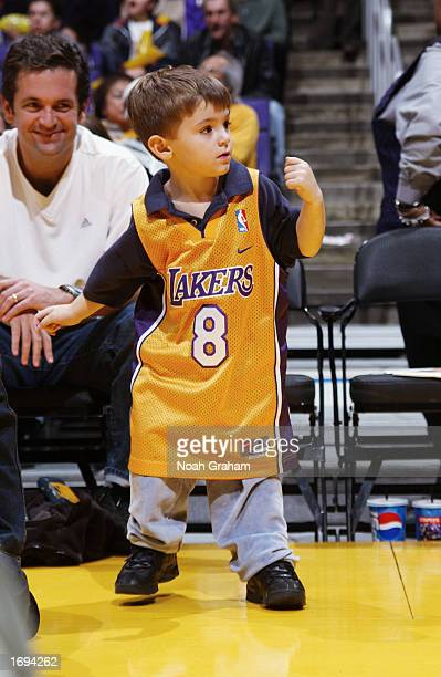 Young fan of Kobe Bryant of the the Los Angeles Lakers watches the game against the Utah Jazz at Staples Center on December 8, 2002 in Los Angeles,...