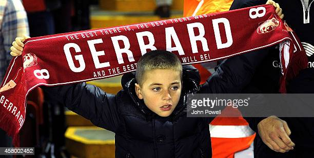 Young fan of Liverpool holds his scarf in support of Steven Gerrard during the Capital One Cup Fourth Round match between Liverpool and Swansea City...