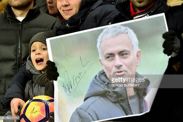 A young fan of Manchester United FC shouts near a portrait of the coach Jose Mourinho during the UEFA Europa League football match between FC Zorya...