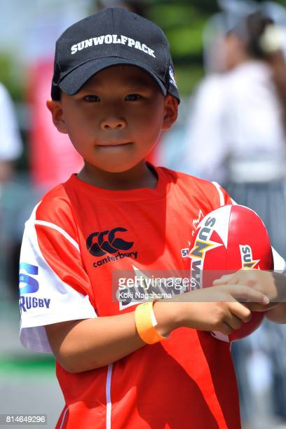 A young fan of Sunwolves poses for a photographs during the Super Rugby match between the Sunwolves and the Blues at Prince Chichibu Stadium on July...