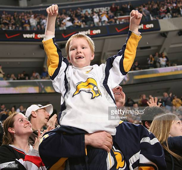 Young fan of the Buffalo Sabres cheers a goal scored against the Pittsburgh Penguins on February 17, 2008 at HSBC Arena in Buffalo, New York.