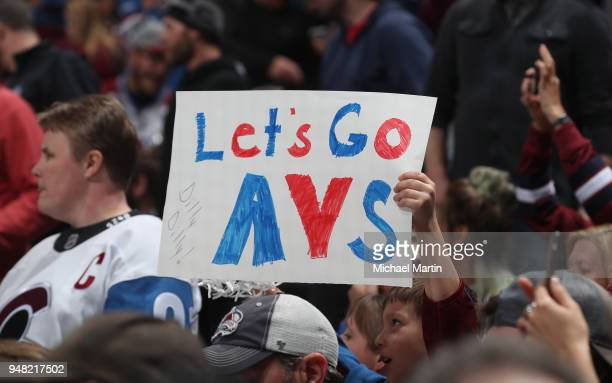 A young fan of the Colorado Avalanche hold up a sign during the game against the Nashville Predators in Game Three of the Western Conference First...
