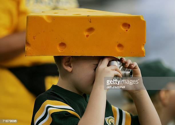A young fan of the Green Bay Packers takes pictures during warmups before a game against the Atlanta Falcons on August 19 2006 at Lambeau Field in...