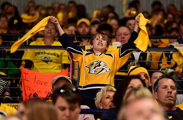 Young fan of the Nashville Predators waves rally towels during the first period in Game Six of the Western Conference First Round against the Anaheim...