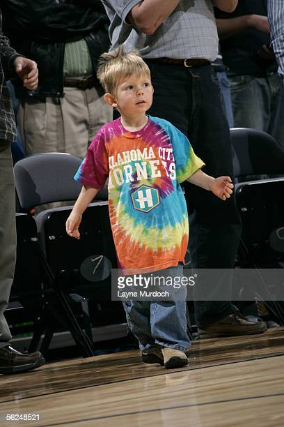 Young fan of the New Orleans/Oklahoma City Hornets cheers on his team against the Orlando Magic November 9, 2005 at the Ford Center in Oklahoma City,...