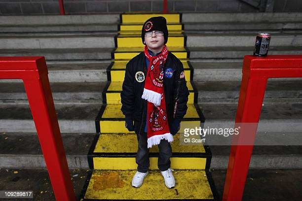 A young fan of the nonleague football club Crawley Town poses in Broadfield Stadium before boarding coaches to Manchester to watch their team take on...
