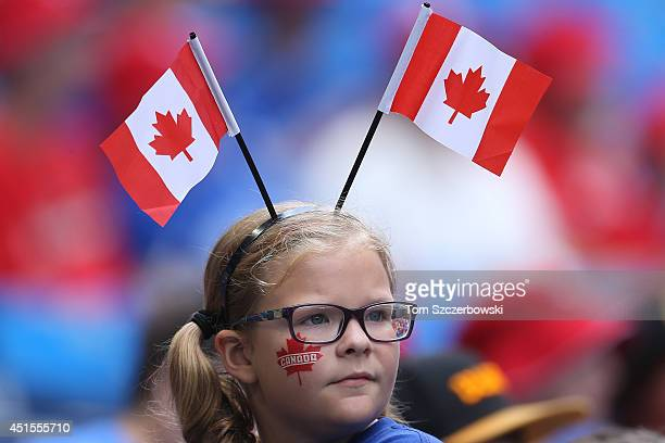 A young fan of the Toronto Blue Jays celebrates Canada Day before the start of MLB game action against the Milwaukee Brewers on July 1 2014 at Rogers...