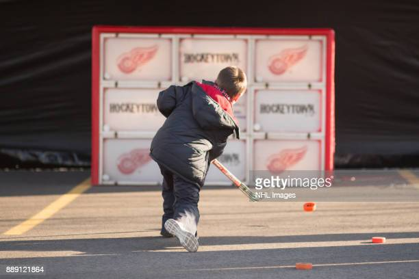 A young fan participates in the activities during the NHL Centennial Fan Arena Truck Tour stop on Cass Avenue on December 3 2017 in Detroit Michigan