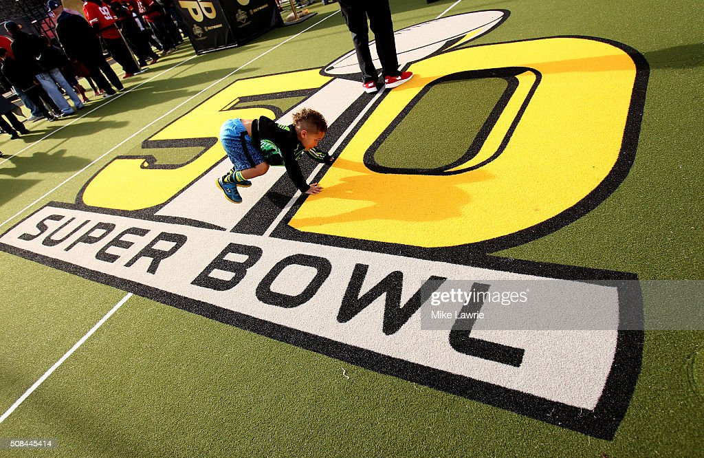 A young fan plays on the logo at The 50th Mile on Market Street prior to Super Bowl 50 on February 4, 2016 in San Francisco, United States.