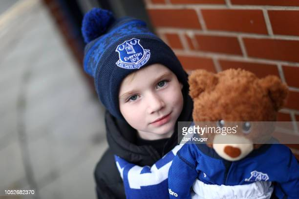 A young fan pose for a photo when arriving outside the stadium prior to the Premier League match between Everton FC and Crystal Palace at Goodison...