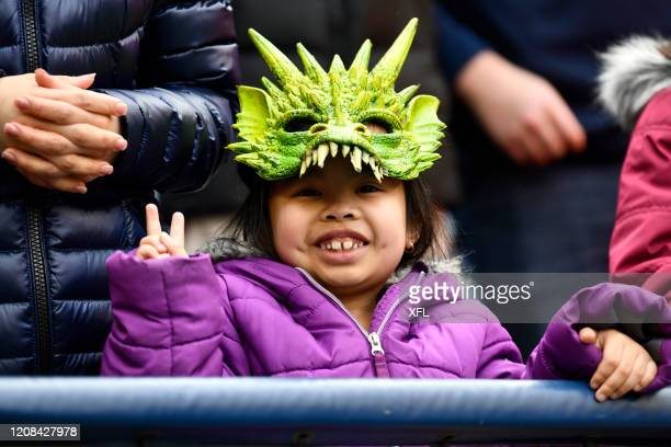 Young fan poses for a photo during the XFL game between the Dallas Renegades and the Seattle Dragons at CenturyLink Field on February 22, 2020 in...