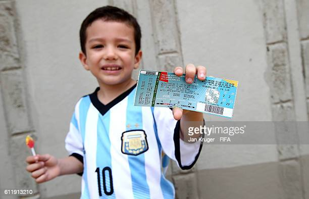 A young fan poses with his ticket during the FIFA Futsal World Cup final between Russia and Argentina at Coliseo el Pueblo on October 1 2016 in Cali...