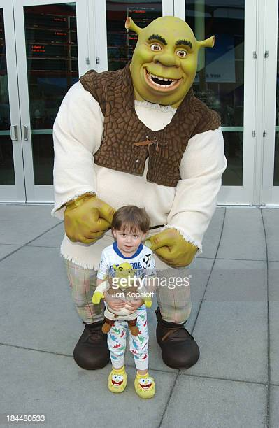 """Young fan poses with Shrek during DreamWorks' """"Shrek 2"""" Opening Day Special Screening And Waffle Breakfast at ArcLight Cinerama Dome in Hollywood,..."""