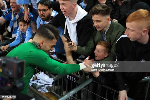 A young fan reacts as he receives the gloves worn by Ederson of Manchester City during the Premier League match between Tottenham Hotspur and...