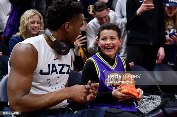 A young fan receives a signed warmup shoe from Donovan Mitchell of the Utah Jazz prior to a NBA game between San Antonio Spurs and the Utah Jazz at...