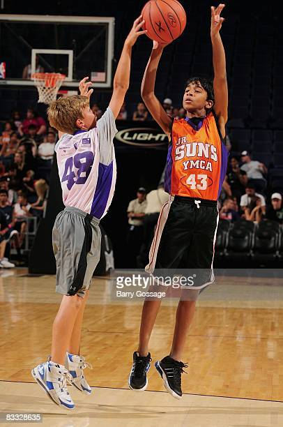 Young fan shoots a jumper during the Phoenix Suns open practice on October 5 at U.S. Airways Center in Phoenix, Arizona. NOTE TO USER: User expressly...