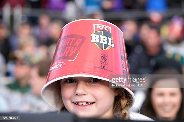 A young fan show her support during the Big Bash League match between the Hobart Hurricanes and Adelaide Strikers at Blundstone Arena on January 2...