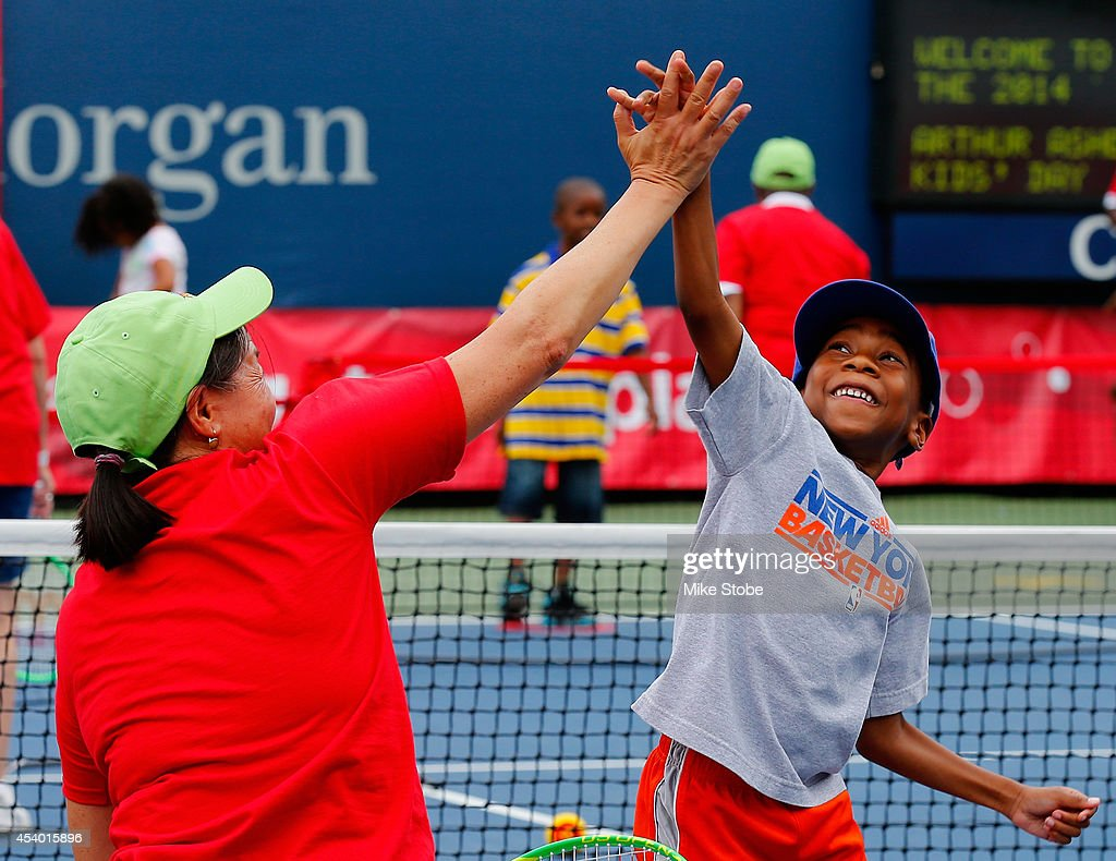 A young fan shows excitement while participating in Arthur Ashe Kids' Day prior to the start of the 2014 U.S. Open at the USTA Billie Jean King National Tennis Center on August 23, 2014 in the Flushing neighborhood of Queens in New York City.