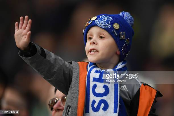 A young fan shows his support during the Premier League match between Huddersfield Town and Everton at John Smith's Stadium on April 28 2018 in...