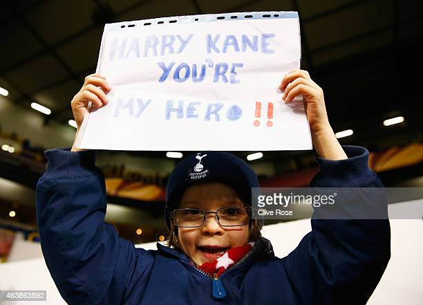 A young fan shows support for Harry Kane of Spurs prior to the UEFA Europa League Round of 32 first leg match between Tottenham Hotspur FC and ACF...