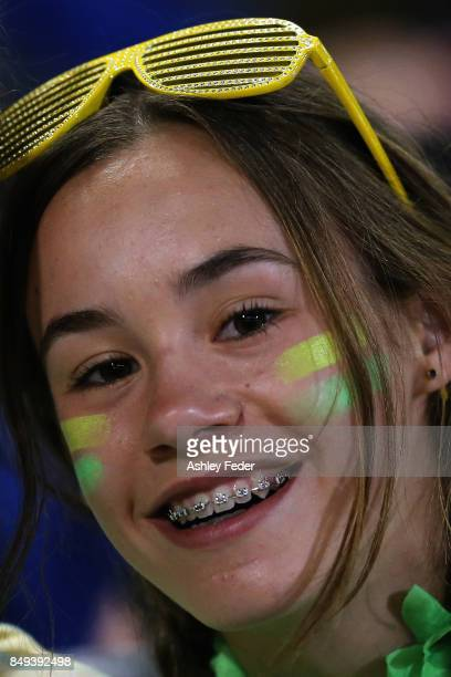 A young fan shows their support during the Women's International match between the Australian Matildas and Brazil at McDonald Jones Stadium on...