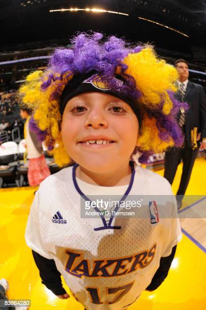 A young fan stands on the court before the game between the Toronto Raptors and the Los Angeles Lakers at Staples Center on November 30 2008 in Los...
