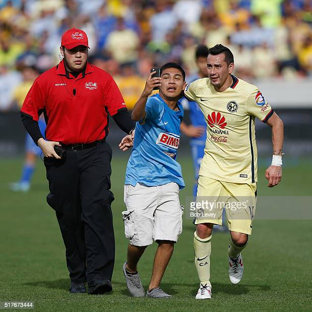 A young fan takes a selfie with Rubens Sambueza of Club America as security escorts him off the field at BBVA Compass Stadium on March 26 2016 in...