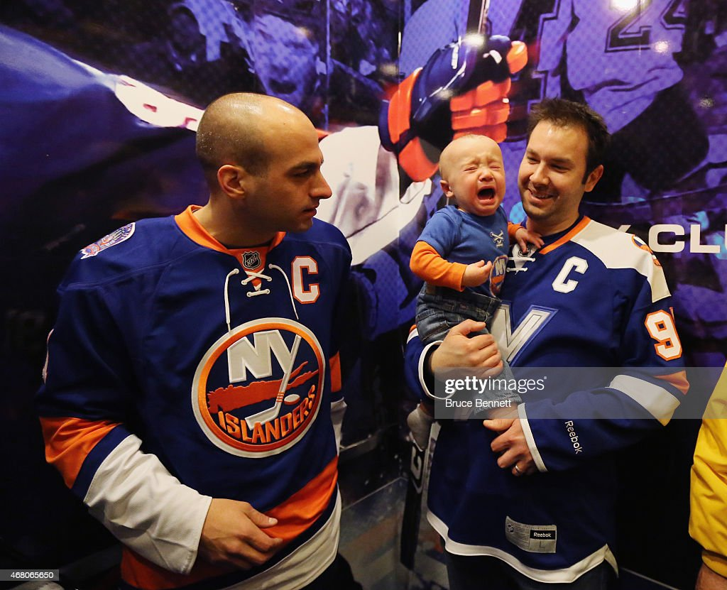 A young fan takes the elevator ride from the skyboxes to street level prior to the game between the New York Islanders and the Detroit Red Wings at the Nassau Veterans Memorial Coliseum on March 29, 2015 in Uniondale, New York. The Islanders defeated the Red Wings 5-4.