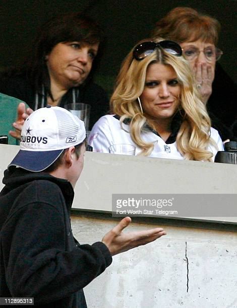 A young fan tries to get Jessica Simpson's attention as the Philadelphia Eagles play the Dallas Cowboys at Texas Stadium Sunday December 16 in Irving...