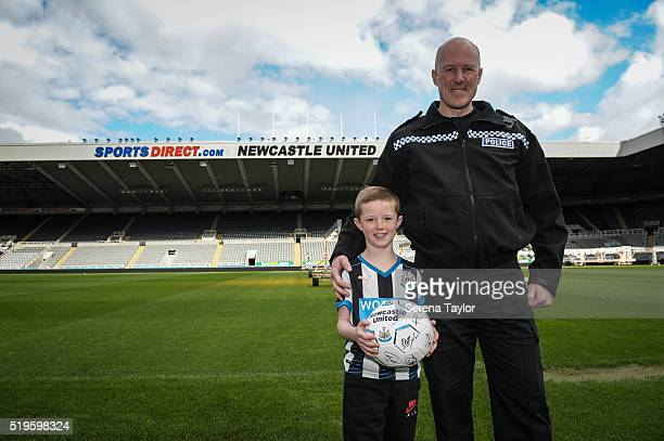 Young Fan Tyler Heaviside and Sergeant Neil Pacey of Northumbria Police pose for photographs pitch side during a Media Call for the young fan who...