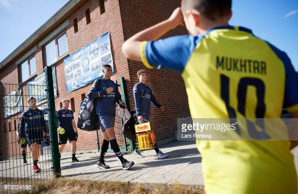 A young fan waiting for the Brondby IF players to arrive prior to the Brondby IF training session at Brondby Stadion on June 13 2018 in Brondby...