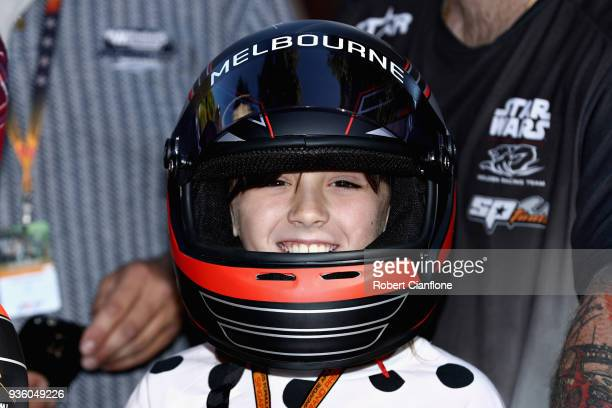 A young fan waits for the drivers to arrive during previews ahead of the Australian Formula One Grand Prix at Albert Park on March 22 2018 in...