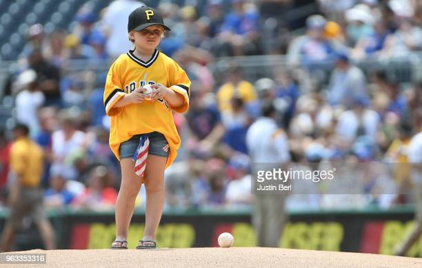 A young fan waits on the pitchers mound for Chad Kuhl of the Pittsburgh Pirates before the first inning during the game against the Chicago Cubs at...