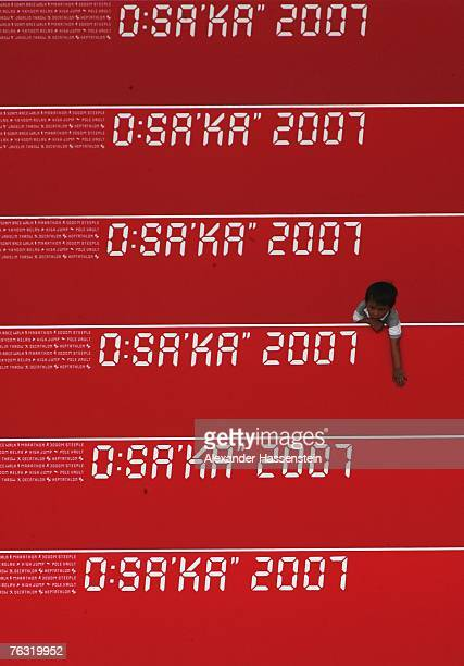 Young fan watches from the grandstand during day one of the 11th IAAF World Athletics Championships on August 25 2007 at the Nagai Stadium in Osaka...