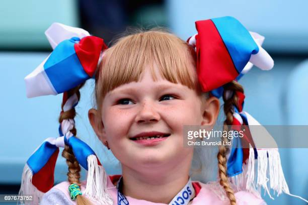 A young fan watches the action during the FIFA Confederations Cup Russia 2017 Group B match between Australia and Germany at Fisht Olympic Stadium on...