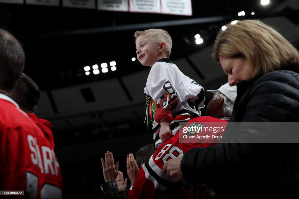 A young fan watches the ice after the Chicago Blackhawks scored against the Boston Bruins in the third period at the United Center on March 11, 2018 in Chicago, Illinois.