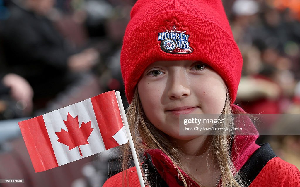 A young fan watches the warm-up skate during Hockey Day In Canada prior to the start of a game between the Ottawa Senators and the Edmonton Oilers at Canadian Tire Centre on February 14, 2015 in Ottawa, Ontario, Canada.