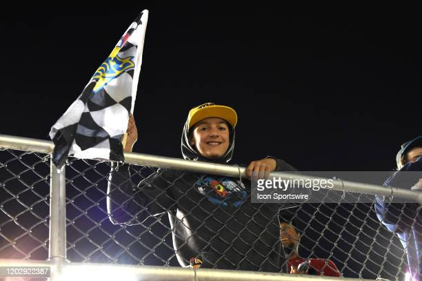 A young fan waves the Sunoco checkered flag after it was given to him by Chase Briscoe BiagiDenbeste Ford XS Mustang following his race victory...