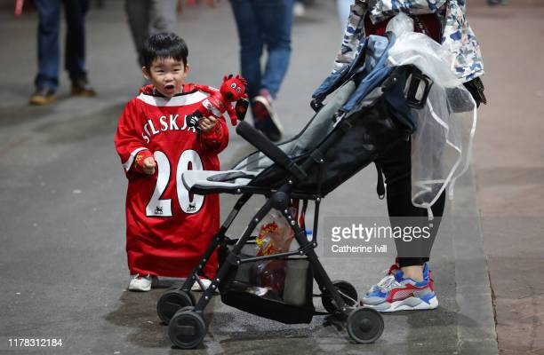 A young fan wearing s shirt of Ole Gunnar Solskjaer manager of Manchester United ahead of the Premier League match between Manchester United and...
