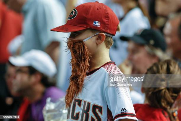 A young fan wears a beard when Arizona Diamondbacks relief pitcher Archie Bradley enters the game during the MLB National League Wild Card baseball...