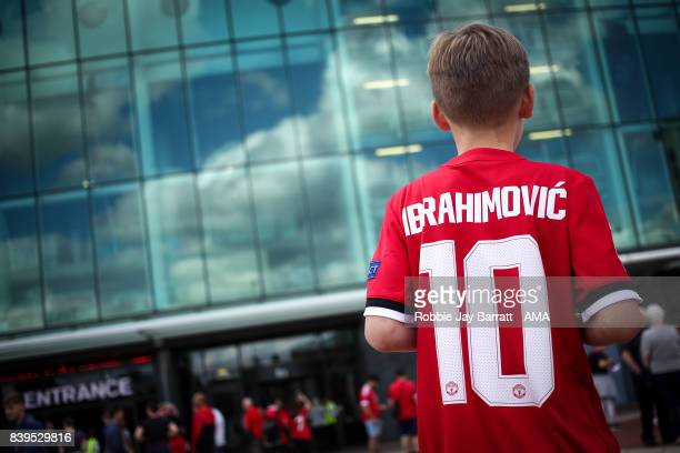 A young fan wears a Zlatan Ibrahimovic of Manchester United shirt prior to the Premier League match between Manchester United and Leicester City at...