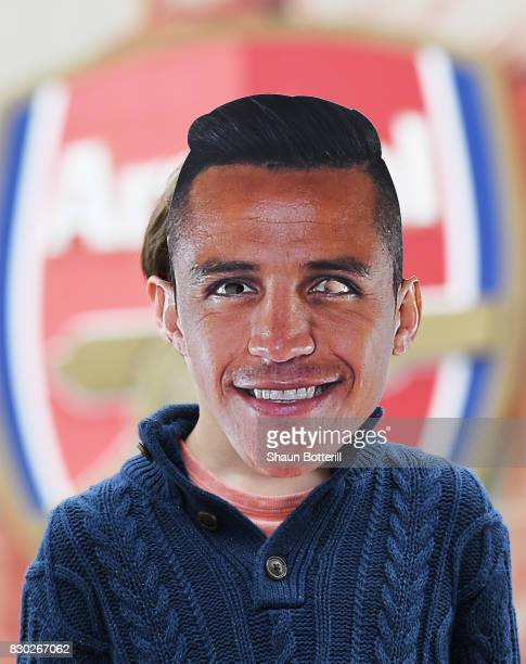 A young fan wears an Alexis Sanchez of Arsenal mask prior to kickoff during the Premier League match between Arsenal and Leicester City at the...