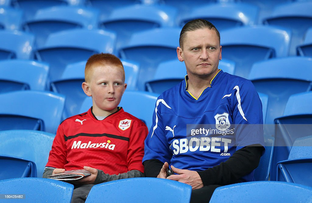 A Young Fan Wears The New Controversial Cardiff City Red Kit Whilst