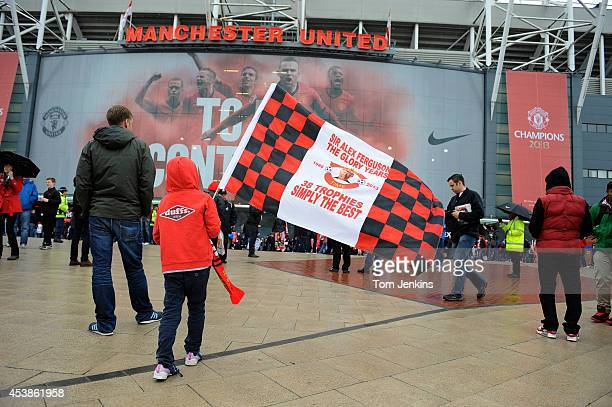 A young fan wit a flag outside the ground before the Manchester United versus Swansea City Barclays Premier League match the final home game for Sir...